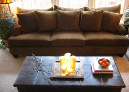 Cary NC living room with Z Gallerie sofa and coffee table and candles on mirror