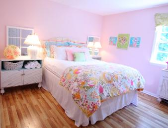 Guest room Cary NC with custom paint mix between  Sherwin Williams Possibly Pink and Charming Pink Red Chair Home Interiors