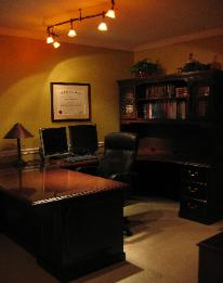 Cary, NC home office with track lighting and executive desk Red Chair Home Interiors