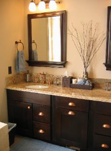 Cary, NC Master bathroom with espresso cabinets, copper cup pulls, and accents from Pottery Barn and World Market including Pottery Barn Metropolitan Mirror With Shelf