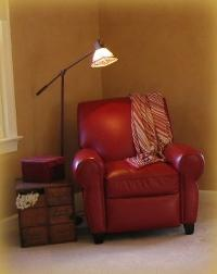 Red leather chair in bedroom in Apex NC