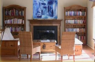 Cary NC living room with original abstract art over mantel