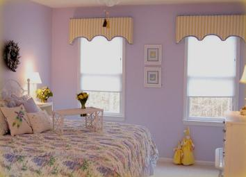 Durham, NC retreat center bedroom showing use of complimentary colors purple and yellow cottage style custom cornices Red Chair Home Interiors