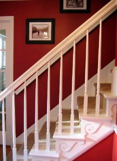Red foyer with white painted stairs in Cary NC Ralph Lauren Chimayo Red Paint