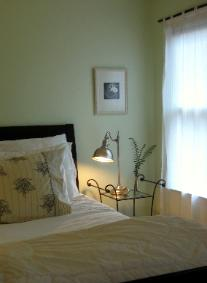Green bedroom in Cary NC with brushed nickel lamp and bamboo curtain rod Red Chair Home Interiors