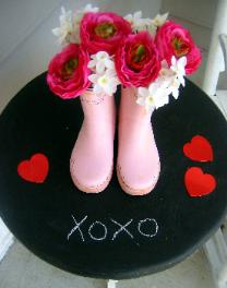 DIY chalkboard table with boots used as flower vase for Valentine's Day decor Red Chair Home Interiors